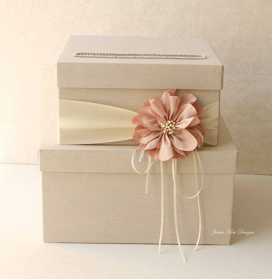 Nude Peach Wedding Card Box: This nude peach wedding card box ($102) with the dusty pink flower would be a pretty addition to your nuptials.