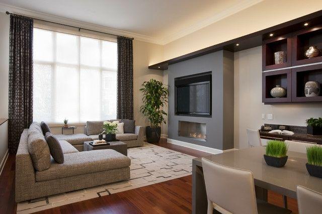 salon moderne avec télé et cheminée encastrées