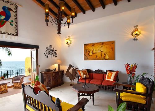 Mexican style living room with mix of colonial baroque and those ubiquitous beach chairs one sees everywhere in mexico made from palm tree bark.