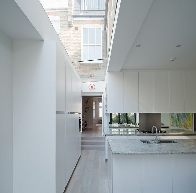 glazing that brings the whole house into the design of the extension - nice storage and example of using glass to create feel of see through back to the original lounge