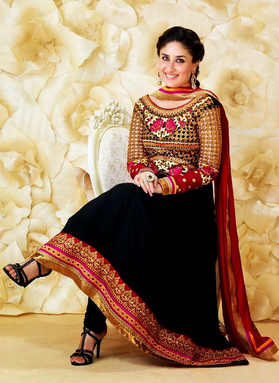 Kareena Kapoor looks stunning in this black anarkali with shades of red/pink and golden embroidery. Source: styleinheaven.com