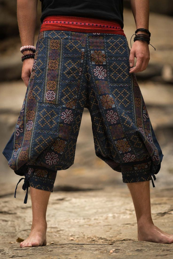 """Amazing Unique High Cut Harem Pants made from fairtrade beautiful traditional hill tribe fabric from the North of Thailand. With open-side legs and ankle cuffs with adjustable straps, you can move freely while practicing yoga, doing the split, or chasing butterflies in the mountains of Pai. Suitable for both men and women. Elastic waist on the back allows the pants to fit most sizes. Measurement: Waist: 26""""to 33"""" Hips: up to 42"""" Crotch: 17"""" Inseam: 20"""" Total length: ..."""