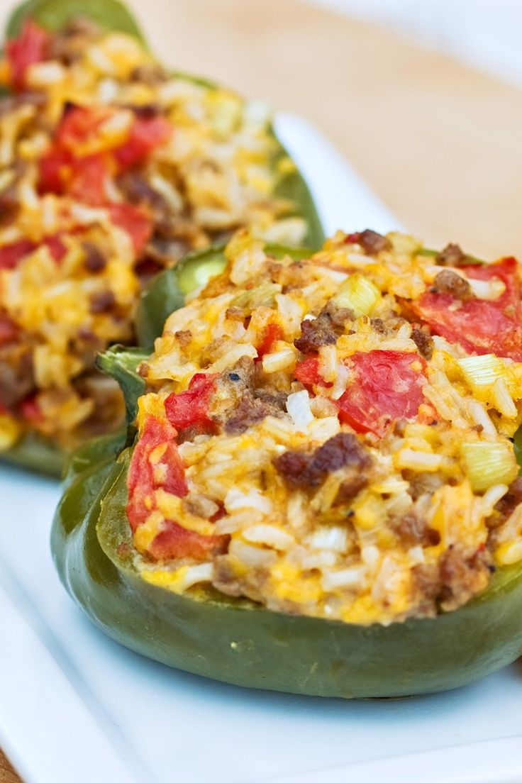 Ground Beef Stuffed Green Bell Peppers With Cheese Recipe With Onion Tomatoes Rice And Cheddar Cheese Stuffedpeppers G Stuffed Peppers Recipes Beef Dishes