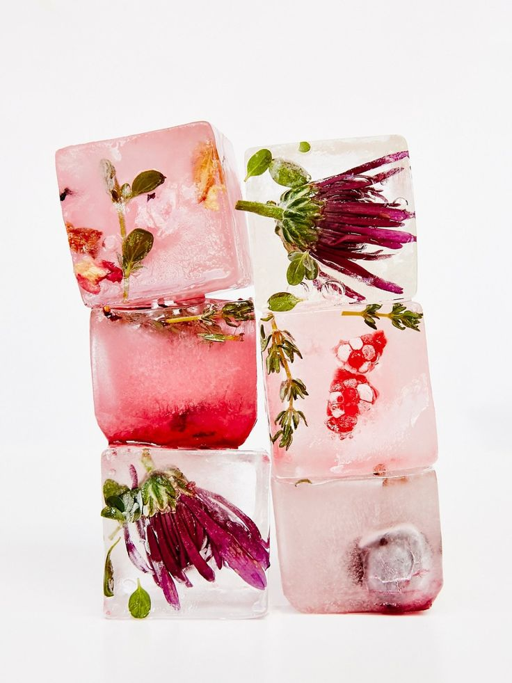 Flower Ice Mold Kit | Make beautiful and unique accessories for your favorite drinks with this floral ice kit. Features a BPA-free, dishwasher safe ice tray with four extra large ice square molds and a container of edible dried flowers to decorate the inside of your fancy frozen cubes.