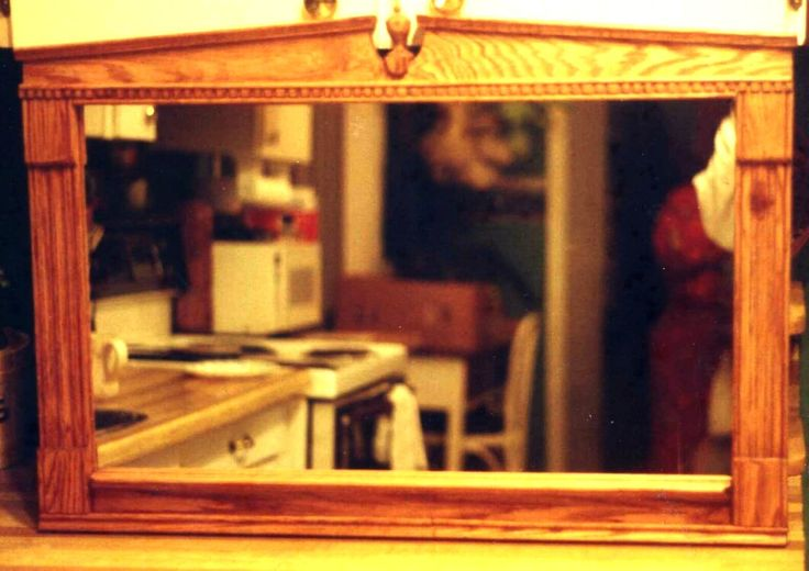 Framed mirror crafted from red oak - with architectural details. Commission made in 2000.