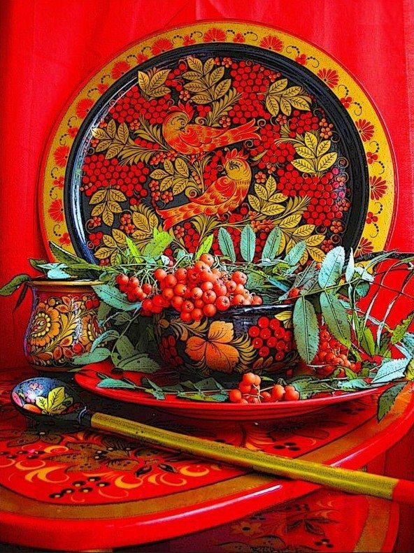 Wooden dishes and a table decorated with folk Khokhloma painting from Russia. #art #folk #painting #Russian