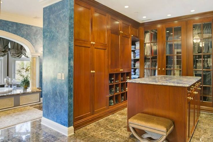 Craftsman Closet with River White Granite Countertop, Luxury Wood Custom Closets, complex marble tile floors, High ceiling