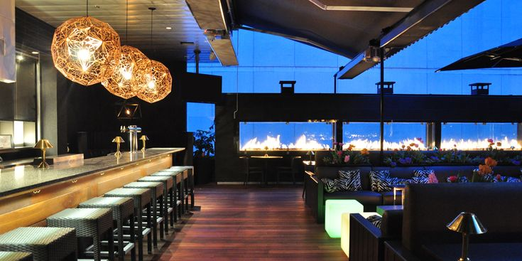 Downtown; HH until 5:30pm; $5 Wine & $1.50 oysters; Rooftop Bar with Fireplaces (plural!!)