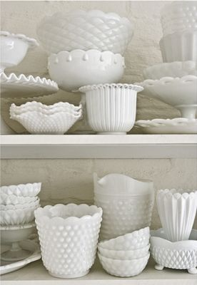 milk glass ideas. Not sure if you're a fan of milk glass but you could keep your eyes open on etsy and ebay for random milk glass as accent pieces for you kitchen if you need it. Seems beachy to me :)