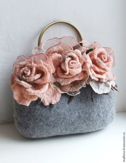 This is a handmade grey felt bag. I loved the detail of the big roses on the top, it is quite cute, but not for a party girl ensemble.
