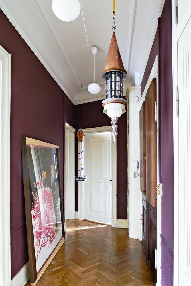 dark aubergine walls, hallway
