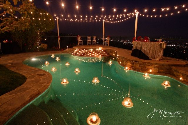 Pretty pool settings - get the glass vases that float in water and fill with teacup candles ...