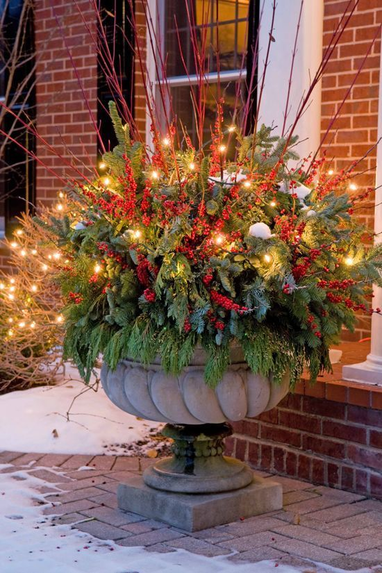 Add lights to decorative urns for added glow next to your front door. Great for anytime of the year. But great for the holidays. Add Orange lights for Halloween and Thanksgiving. Add warm white or multicolor lights for Christmas. Be sure to use LED lights they stay cool to the touch.