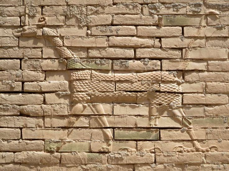 The dragon-like chimera reliefs on the original base of the Ishtar Gate at Babylon, Iraq, bear attributes of a snake, lion, and eagle.