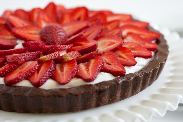 strawberry brownie tart.   walnut meal, cacao powder, honey w/ coconut cream
