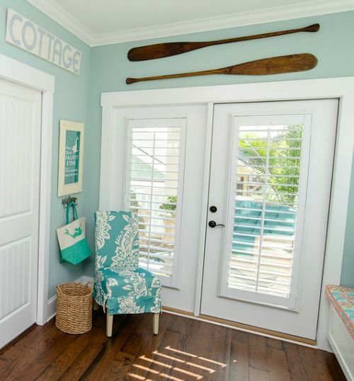 Oar decor for the wall: http://www.completely-coastal.com/2016/05/the-colorful-coastal-cottages-at-ocean-isle.html Oars above doors for a great nautical touch!