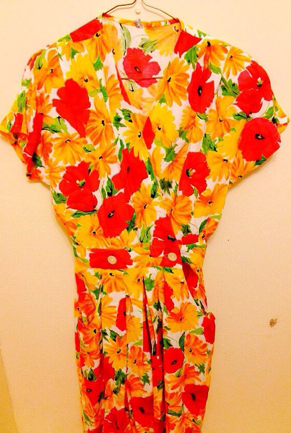 Vintage Floral Pink & Yellow Playsuit  https://www.etsy.com/ie/listing/172235089/vintage-floral-pink-yellow-playsuit?ref=shop_home_feat_2
