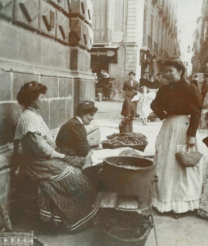Castañera delante de la fachada de la iglesia de Betlem, La Rambla, Barcelona. 11-1917. AFB. Frederic Ballell