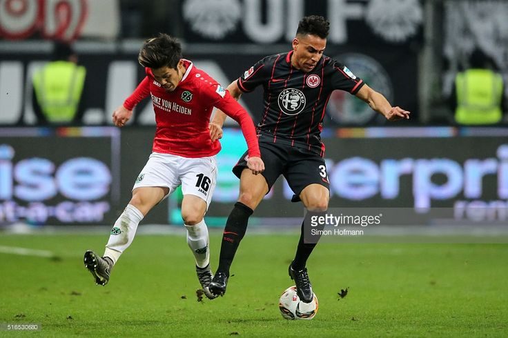 Aenis Ben-Hatira of Frankfurt is challenged by Hotaru Yamaguchi of Hannover during the Bundesliga match between Eintracht Frankfurt and Hannover 96 at Commerzbank-Arena on March 19, 2016 in Frankfurt am Main, Germany.