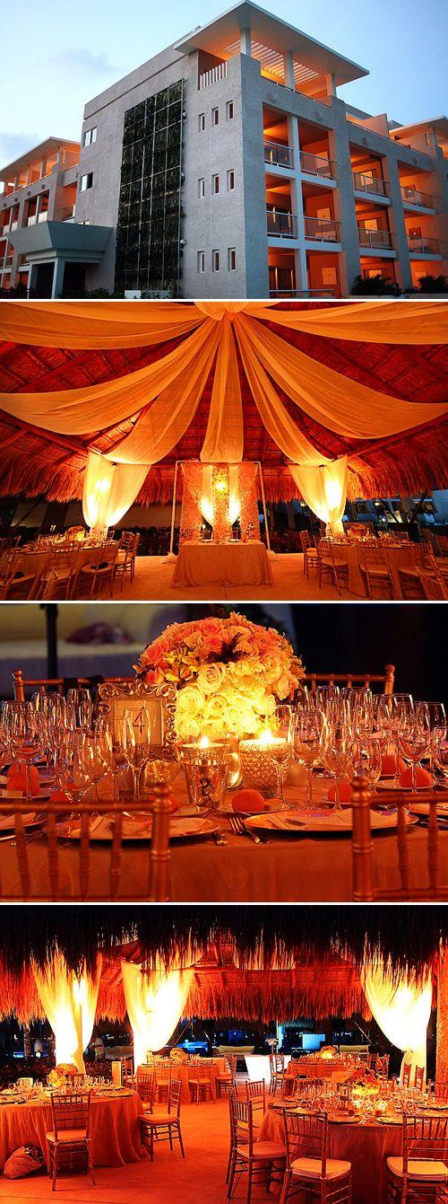 Amazing orange lighting and decor at this destination Playa del Carmen wedding, Photos by Del Sol Photography via JunebugWeddings.com