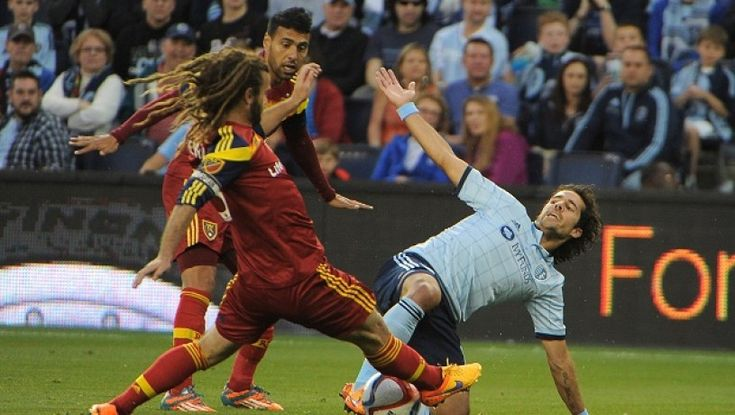 Benny Feilhaber (Sporting Kansas City) battles Kyle Beckerman (Real Salt Lake)