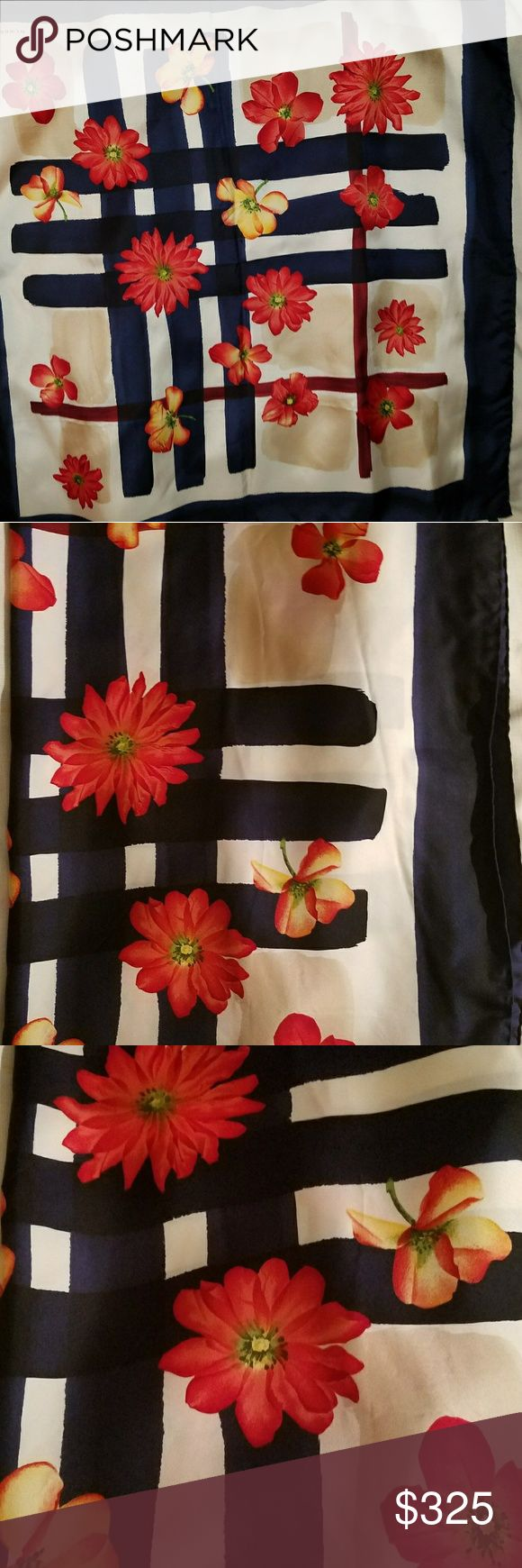 New Burberry Floral large silk scarf, 40 x 40 Check out this hard to find Burberry Silk Scarf. The brilliant red flowers against the navy trim makes a very classic and chic statement. The scarf is new without tags and was made in Italy. Please ask questions. Remember scarves are the 2018 go to accessory. Burberry Accessories Scarves & Wraps