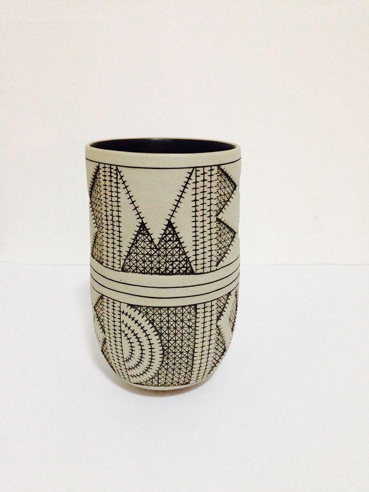Coil built  stoneware pot,black inlay