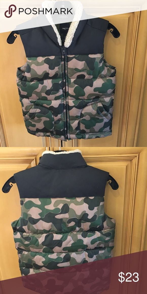 Gap kids boys puffer vest size 6/7 GAP puffer vest in camo print in size 6/7.  2 pockets in front, great condition. GAP kids  Jackets & Coats Vests