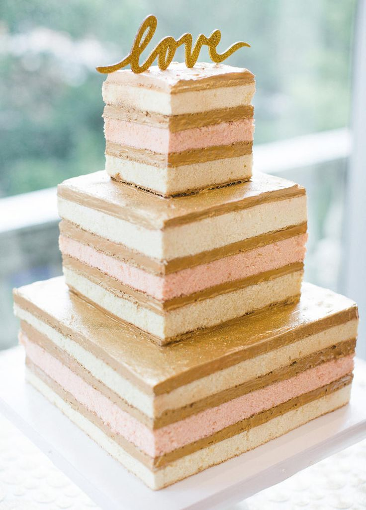 This is one clean-cut confection. The modern design, smooth edges and coordinated colors look so expertly crafted there's no need to garnish with any blooms or berries. l TheKnot.com