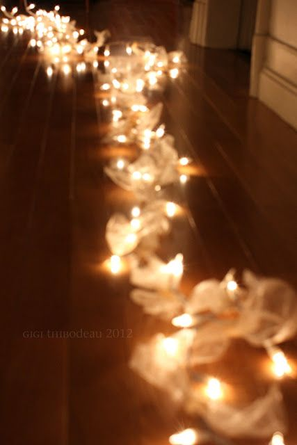 white lights with a white cord and lots of tulle bows to soften