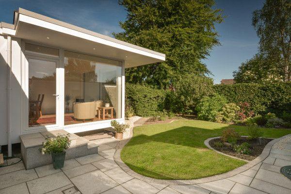 White house + Concrete Pavers + Green Hedges