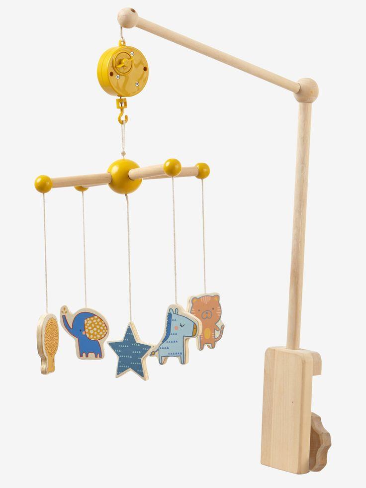 """La nuit s'annonce douce et apaisante pour bébé, bercé par la jolie mélodie de ce très beau mobile musical en bois...   DIMENSIONS : Hauteur 65 cm.  Mobile musical comprenant 5 éléments : 4 petits animaux et une étoile, suspendus par une ficelle (long. 17 cm). Boite à musique colorée, avec positions marche / arrêt. Nom de la mélodie : """"Rock a bye baby"""". Arche et anneau en bois pour accrocher le mobile au-dessus du lit.  CE QU'IL FAUT SAVOIR :  Livré sous valisette de ran..."""
