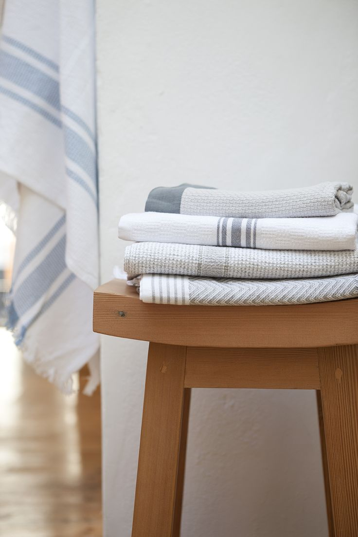 A stack of Mungo flat weave towel s, woven in Plettenberg Bay, South Africa