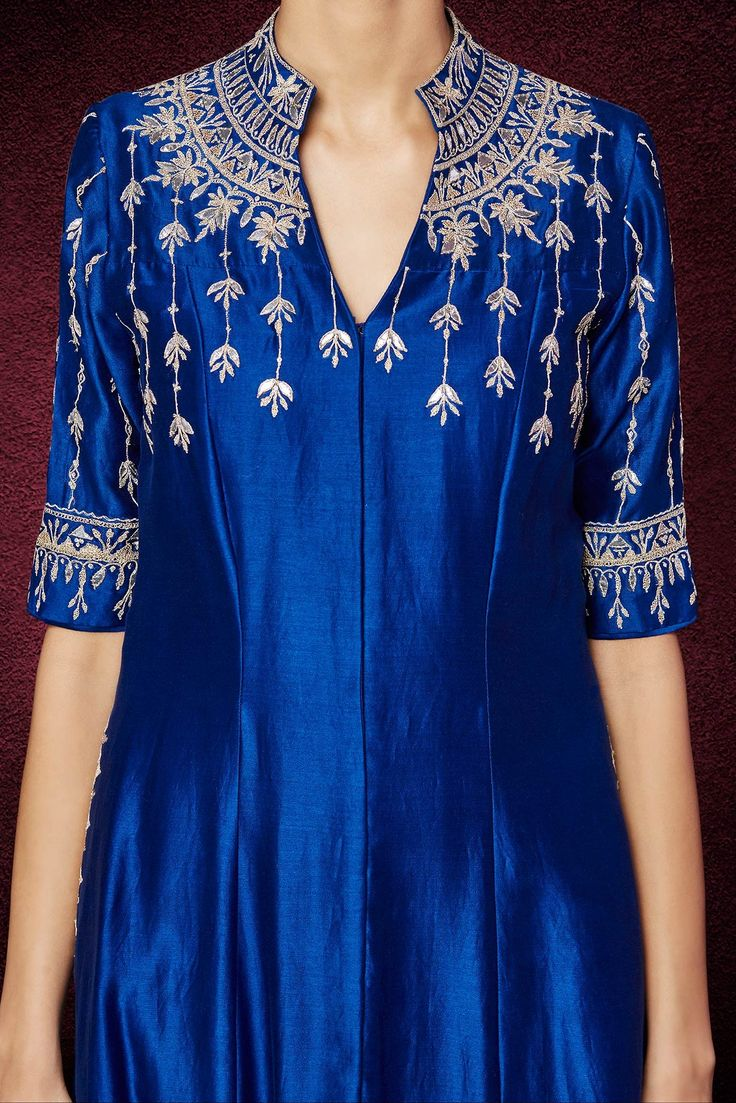 The blue long chanderi silk jacket adorns fine gotta patti, dori and resham work and blends beautifully over the blue chanderi silk pants. For a rich look on any light occasion, style it with drop earrings and a silver clutch.