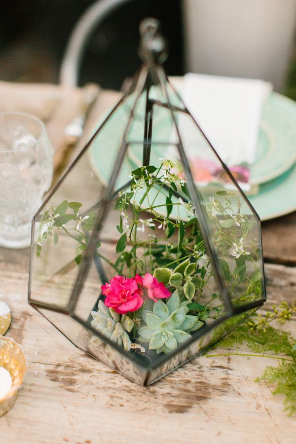 centerpieces contained in a glass terrarium, photo by Love by Serena, styling by Sarah Park Events http://ruffledblog.com/oatlands-plantation-wedding-inspiration #terrariums #wedding #flowers
