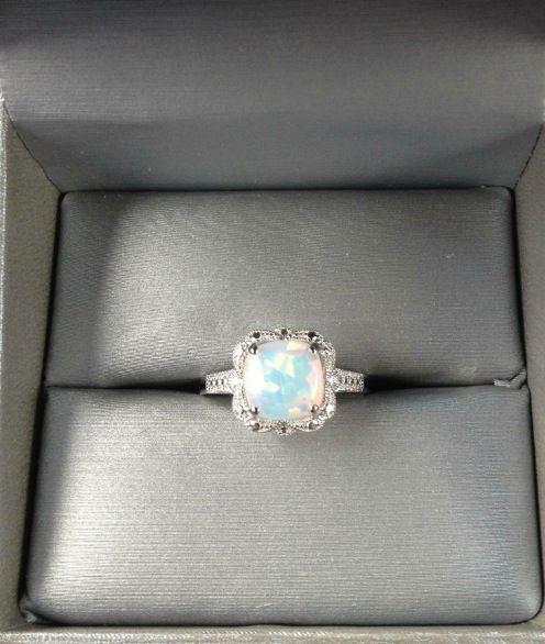 Opal engagement ring...so pretty!