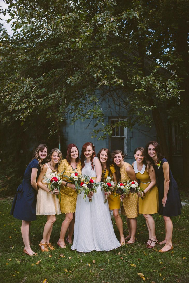 Vintage inspired and mustard and navy blue bridesmaids gowns