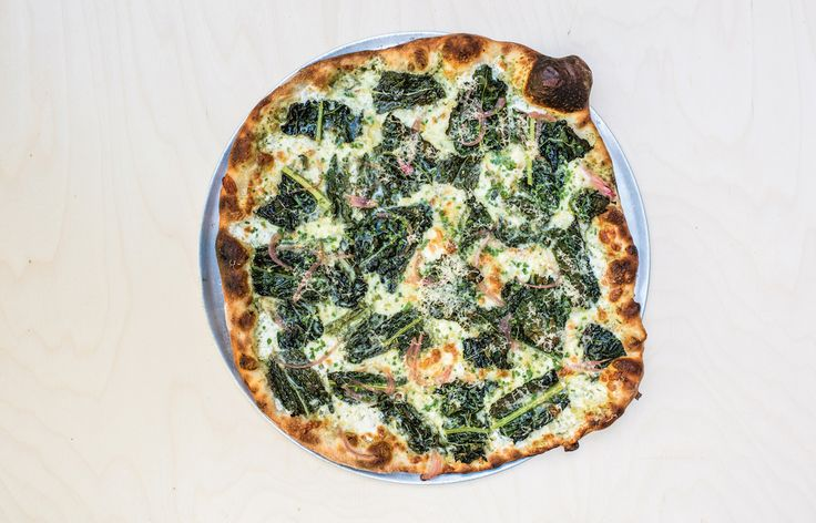 Get ready to make the best pizzas of your life. This dinosaur kale pizza with pickled red onion hits all the right flavor notes.