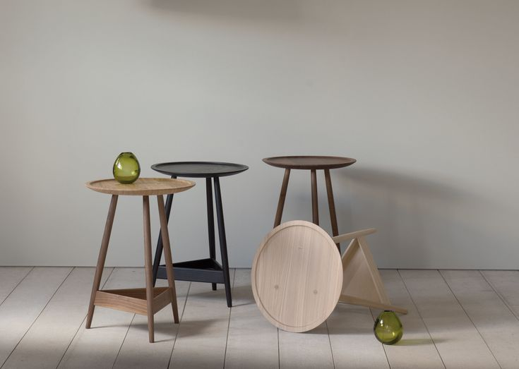 A three-legged occasional table with a turned solid wood top and triangular shelf below.