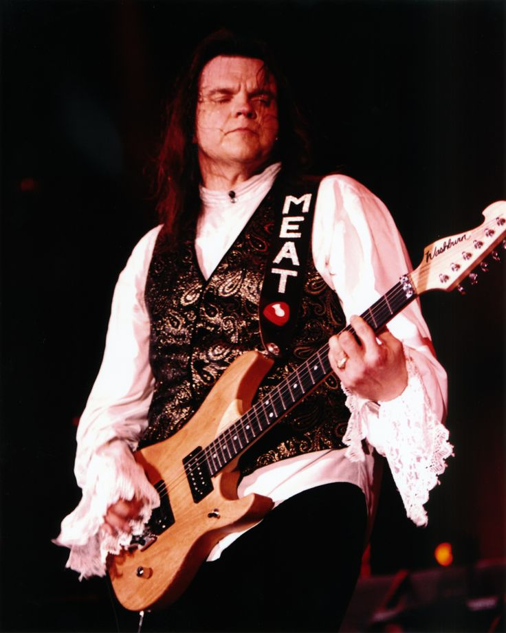 "From the late 1990s.  I love the ""MEAT"" guitar strap...:-)"
