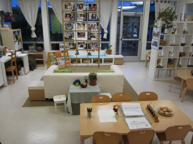 This classroom is Reggio inspired, and I would love to incorporate some of these elements in my own classroom one day. I especially like the small sofa, curtains, and shelving units.
