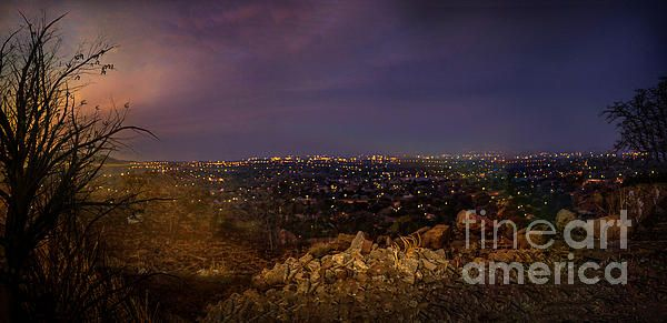 Night Photography of a city Rustenburg South Africa from the hill top nearby. the sun was just going under the horizon line leaving the beautiful twilight colours of the night.