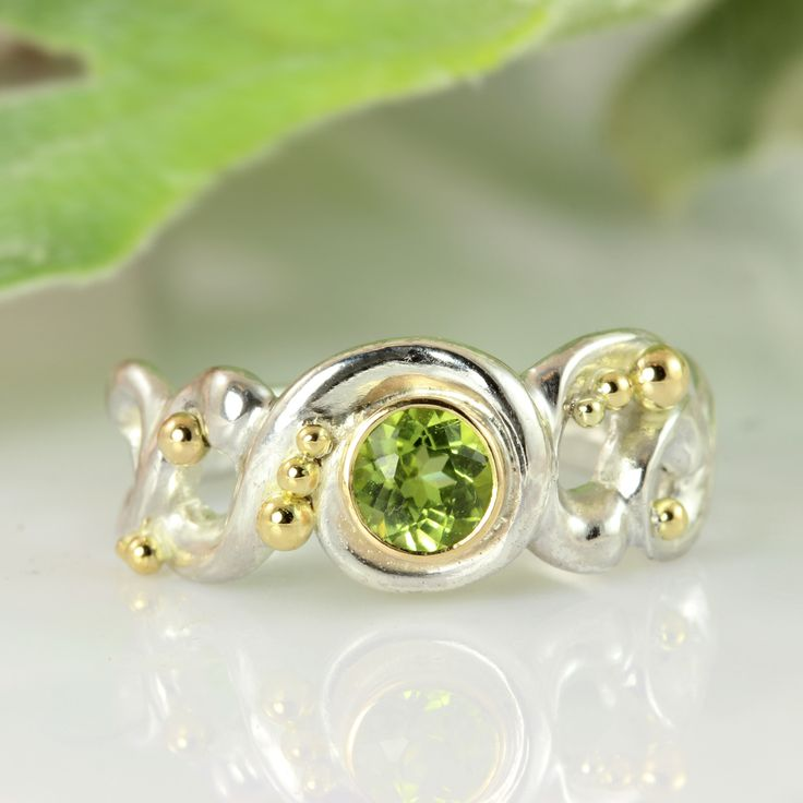 Lace ring of silver with peridot.