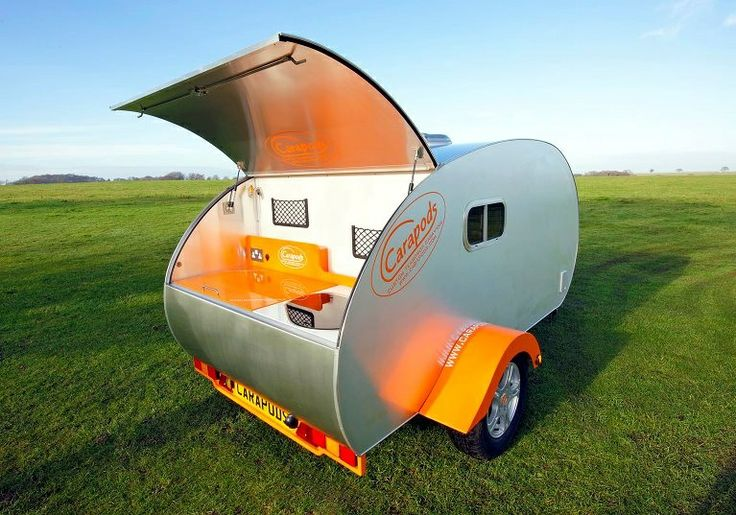 Carapod custom teardrop caravan showing off its curves and stylish galley.