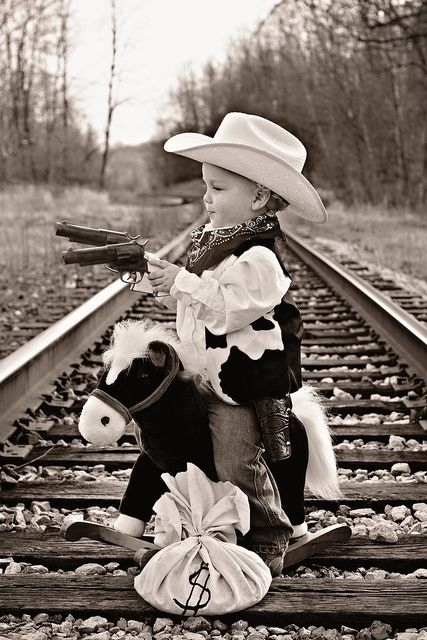 This is a mighty ferocious little tyke! #LittleCowboy #CowboyHat #Cute