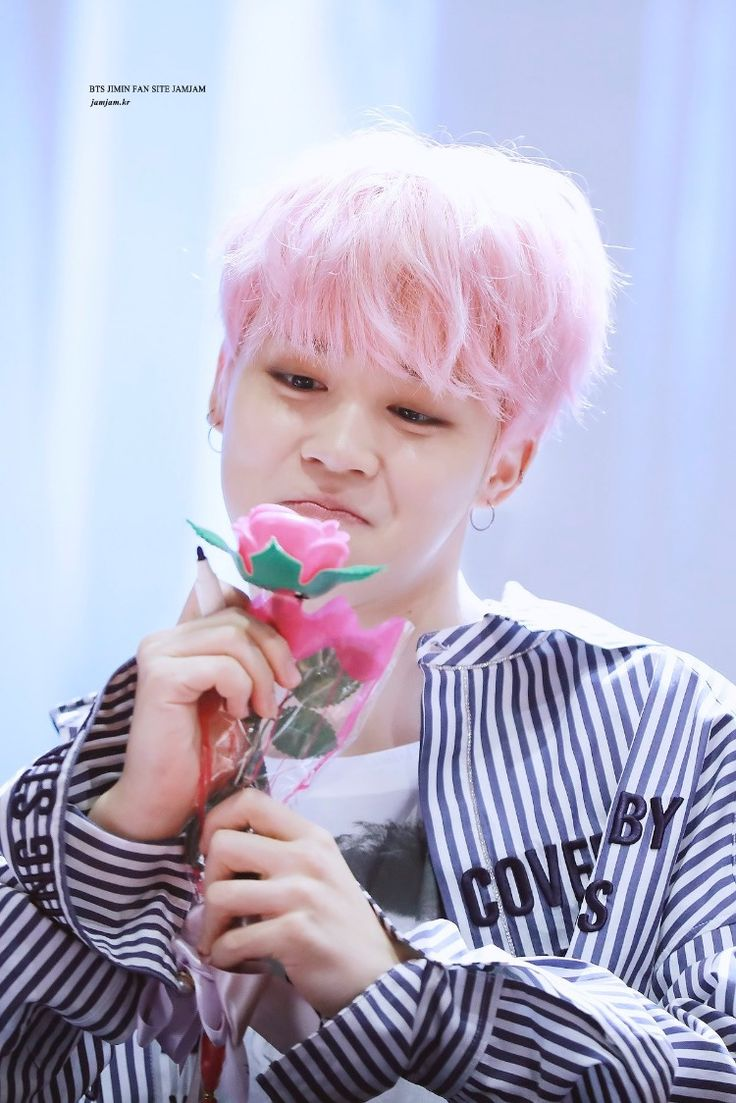 Is that a mirror he's holding because he sure is a flower