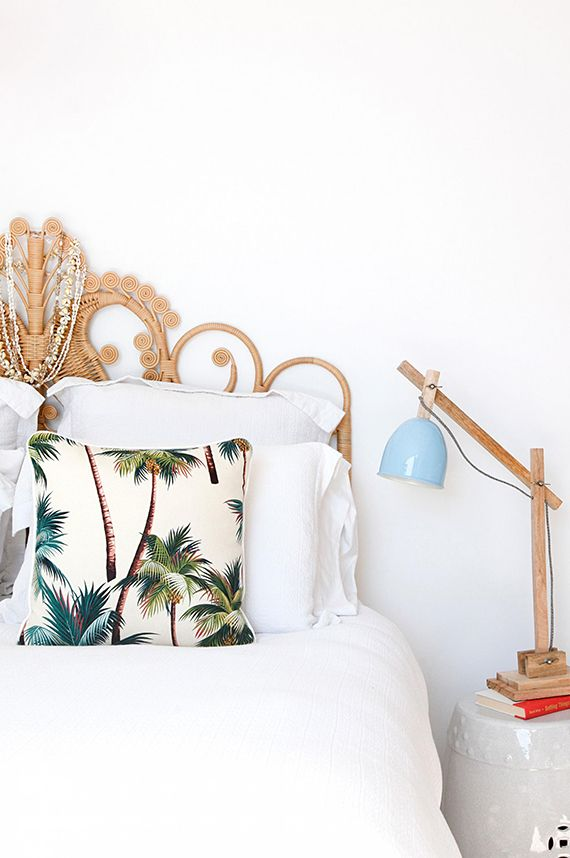 Bedroom with tropical beach vibe and bamboo bed headboard via Inside Out