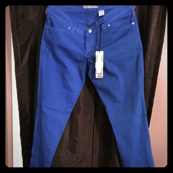 Cute skinny jeans!! These are super cute and bright blue! They fit super skinny and have zero stretch. They should fit a not super curvy size 12. I bought them at a boutique thinking that I would wear them but nope! Nine Planet Jeans Skinny