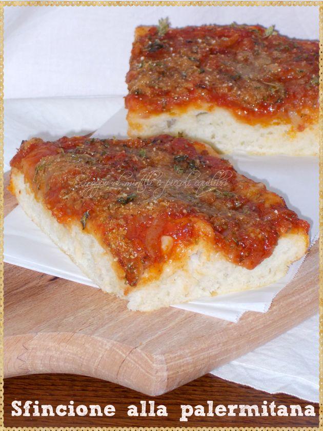 Sfincione alla palermitana (Sfincione of Palermo is a thick Sicilian pizza or focaccia, topped with tomato, onions, anchovies and grated caciocavallo cheese and oregano)