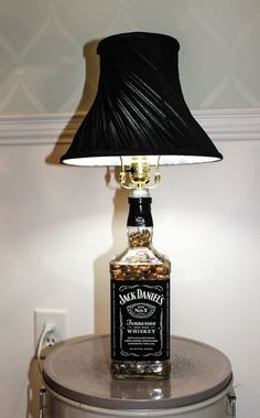 DIY Jack Daniels Lamp- would love to try this with some wine bottles I have!